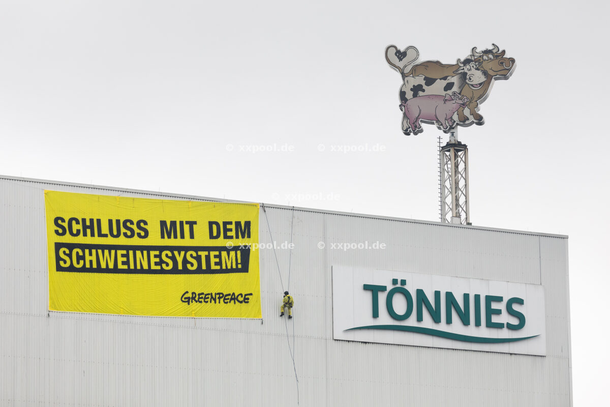 Germany, Rheda-Wiedenbrueck: Greenpeace activists protest with paragliders and banners